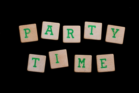 Party time spelled out in old wooden blocks photo