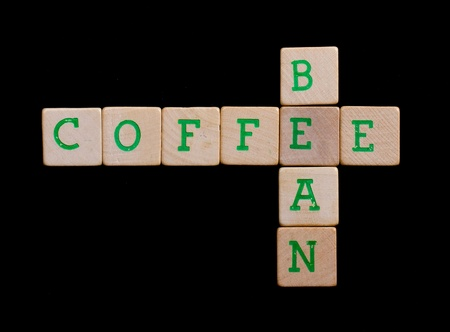 Green letters on old wooden blocks (coffee, bean) photo