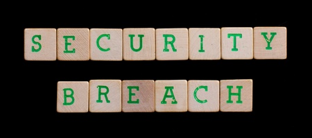 security breach: Green letters on old wooden blocks (security breach)