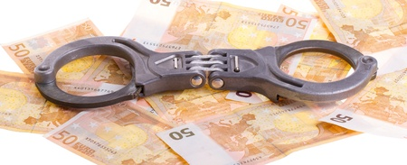 Handcuffs on 50 euro banknotes, isolated on a white background Stock Photo - 13661405