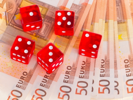 Red dice on top of some 50 euro banknotes Stock Photo - 13661379