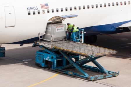 AMSTERDAM - MAY 11: Boeing 767-332ER of Delta is being loaded by ground personal before taking off from Schiphol airport located in Amsterdam, on May 11, 2012, Amsterdam, The Netherlands.