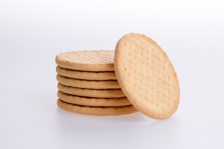 A stack of round biscuits on a grey background Stock Photo - 13661082