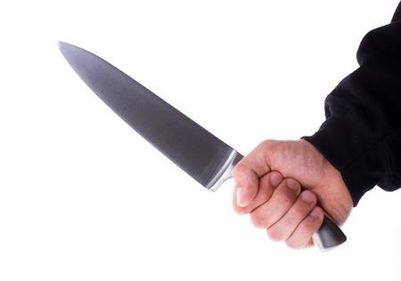 aggressively: Maschio con un coltello affilato nella sua mano Archivio Fotografico