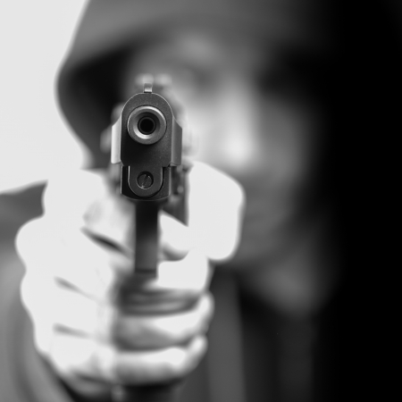 handguns: Man with gun, gangster, focus on the gun Stock Photo