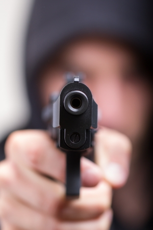 male killer: Man with gun, gangster, focus on the gun Stock Photo