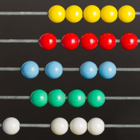 Close-up of an abacus on a grey background Stock Photo
