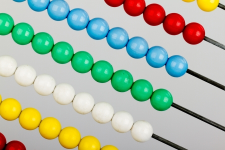 sums: Close-up of an abacus on a grey background Stock Photo