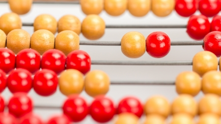 Close-up of an old abacus on a grey background Stock Photo - 13661341