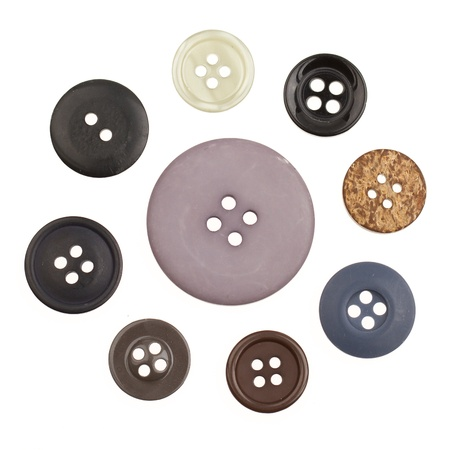A collection of different buttons on a white background photo