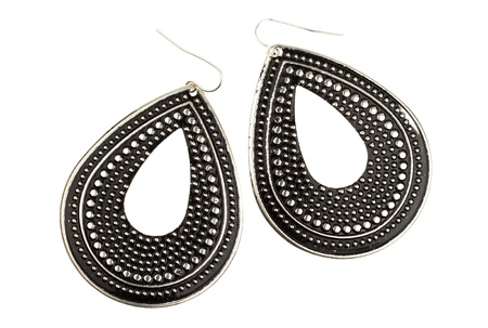 Used large black earrings on a white background photo