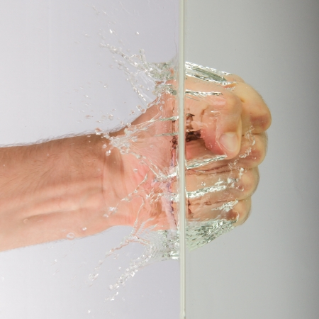 hairy arms: Hand (fist) with splashing water on a white background