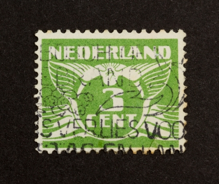 HOLLAND - CIRCA 1940: Stamp printed in the Netherlands shows a drawing with its value, circa 1940 photo