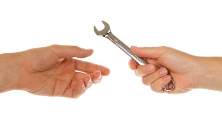 Woman giving a man a shiny wrench photo