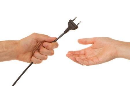 Man giving an electric plug to a woman Stock Photo - 13906447