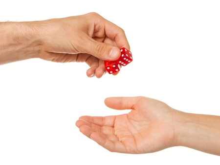 Two red dice being given, man to woman photo