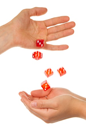 Five red dice being thrown from a hand, man to woman photo