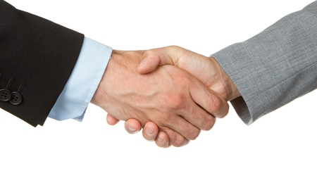 businessmen shaking hands: Close-up of businessman and businesswoman shaking hands