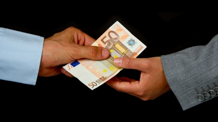 Man giving 50 euro to a woman (business), isolated on black Stock Photo - 13906079