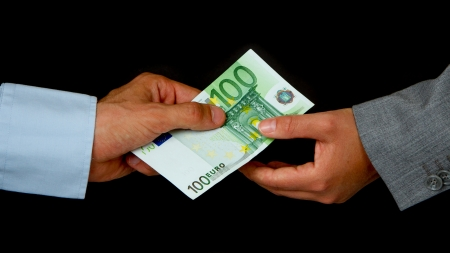 Man giving 100 euro to a woman (business), isolated on black Stock Photo - 13906134