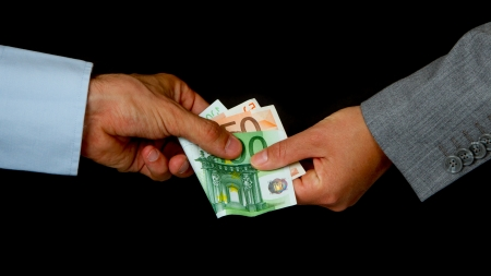 Man giving 150 euro to a woman (business), isolated on black Stock Photo - 13906132