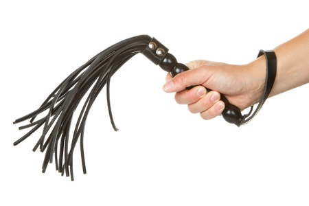 restraints: Strict Black Leather Flogging Whip in womans hand isolated over white background