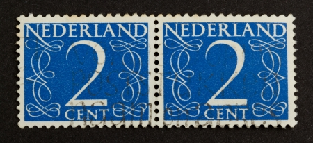 THE NETHERLANDS - CIRCA 1950: Stamps printed in the Netherlands shows the number 2, circa 1950 photo