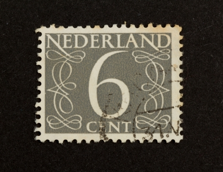THE NETHERLANDS - CIRCA 1950: Stamp printed in the Netherlands shows the number 6, circa 1950 photo