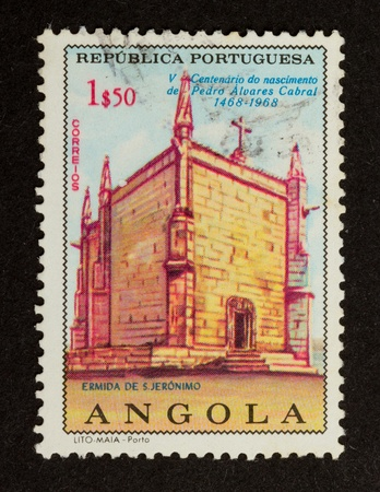 ANGOLA - 1968: Stamp printed in Angola shows an old building, 1968