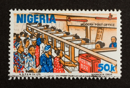 NIGERIA - CIRCA 1980: Stamp printed in Nigeria shows a modern post office 1980 photo