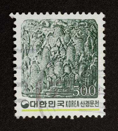 postmail: KOREA - CIRCA 1980: Stamp printed in Korea shows an old drawing of a city, circa 1980 Stock Photo