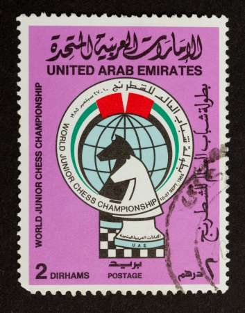 UNITED ARAB EMIRATES - CIRCA 1980: Stamp printed in the UAE shows two chesspieces, circa 1980 photo