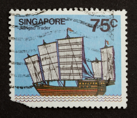 SINGAPORE - CIRCA 1980: Stamp printed in Singapore shows an old chine boat, CIRCA 1980 photo