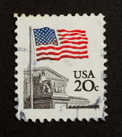 postmail: USA - CIRCA 1975: Stamp printed in the USA shows the Stars and Stripes, circa 1975