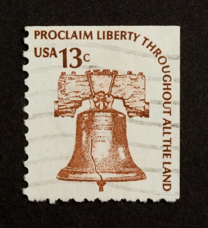 USA - CIRCA 1975: Stamp printed in the USA shows a liberty bell (Proclaim Liberty Throughout All The Land), circa 1975 photo