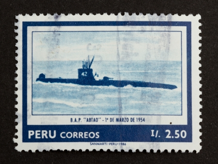 PERU - 1986: Stamp printed in the Peru shows a picture of an old diesel submarine, 1986 photo