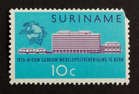 gulden: SURINAME - CIRCA 1970: Stamp printed in Suriname shows a a large building, circa 1970 Editorial