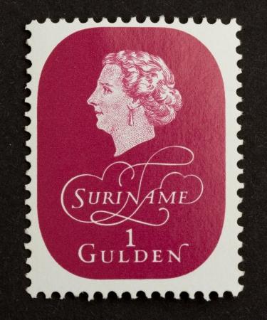 gulden: SURINAME - CIRCA 1980: Stamp printed in Suriname shows a head, circa 1980 Editorial