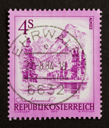 AUSTIA - 1973: Stamp printed in Austia shows a natural scene with mountains and a lake, 1973 photo
