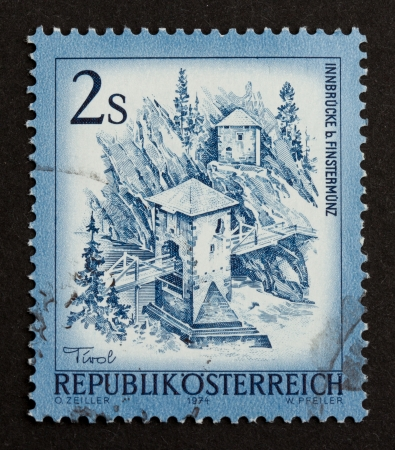 innbruck: AUSTIA - 1974: Stamp printed in Austia shows a natural scene with a tower and a bridge in the mountains, 1974