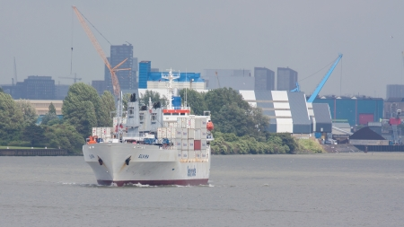 ROTTERDAM, THE NETHERLANDS - JUNE 22: Close-up of a containership engaged in worldwide container transport in Rotterdam on June 22, 2012