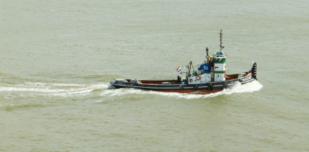 ROTTERDAM, THE NETHERLANDS - JUNE 22: Old tugboat is working in the harbor of Rotterdam (Holland), Rotterdam, June 22, 2012