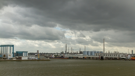 Dark clouds in the sky above the oil refineries in the dutch harbor of Rotterdam