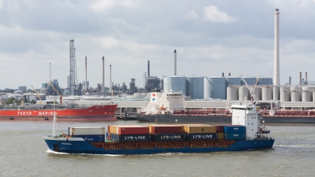 ROTTERDAM, THE NETHERLANDS - JUNE 22: Close-up of a containership, operated by a privately-owned company engaged in worldwide container transport in Rotterdam on June 22, 2012