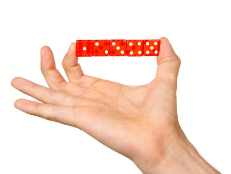 Man holding five red dice isolated on a white background photo