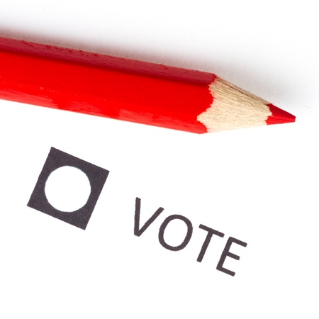 Red pencil used for voting (election America) photo