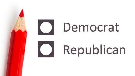 republican: Red pencil choosing between democrat and republican (election America)