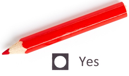 Red pencil choosing between yes or no (voting) photo