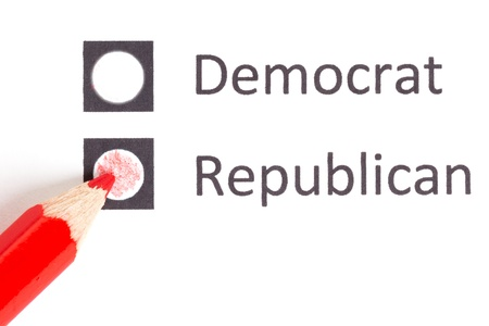 Red pencil choosing between democrat and republican (election America) photo