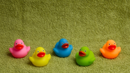 rubbery: Rubber ducks isolated on a green towel, with room for text Stock Photo